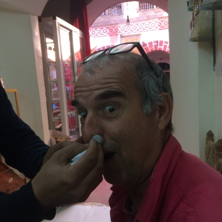 Phil trying the natural snuff to stop snoring, a mixture of eucalyptus and nigella seeds